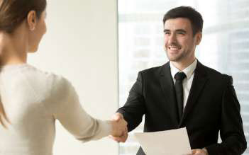 boss-congratulating-female-employee-with-promotion