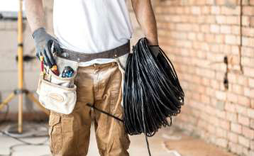 electrician-with-tools-working-construction-site-repair-handyman-concept